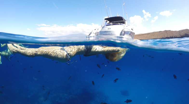 Underwater floating Satisfaction Maui luxury yacht charter